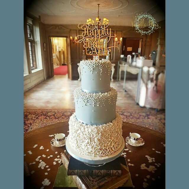 Dusky blue fondant with ruffles and pearls at Thornton Manorhellip