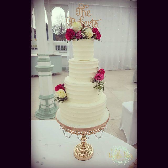 Buttercream wedding cake at the fabulous islagladstone with topper byhellip