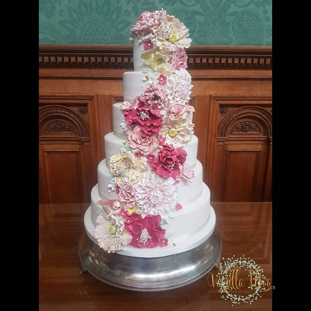 Six tiers of handmade raspberry pink and blush sugar flowershellip